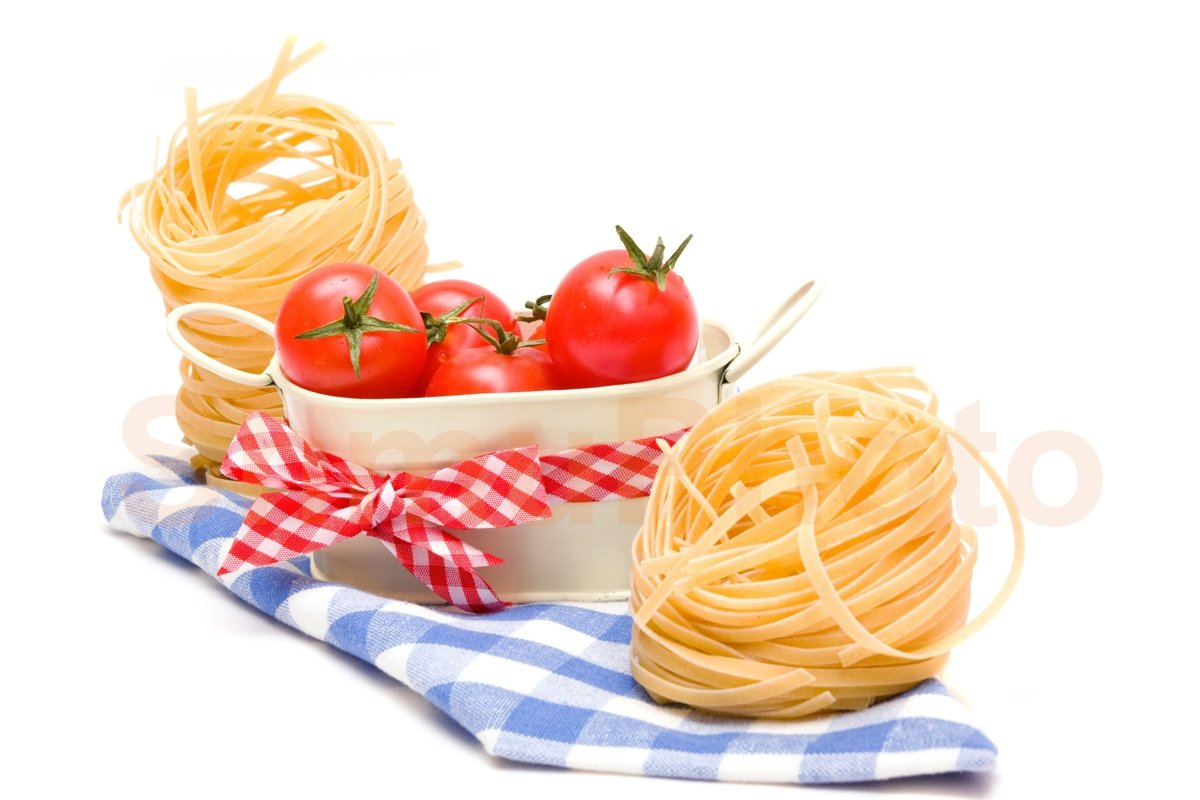 Pasta nest and red tomatoes cherry on plaid napkin example image 1