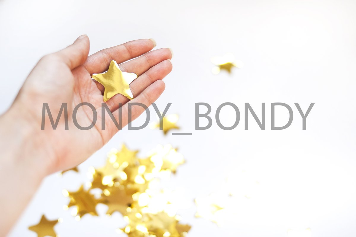 Golden star in hand on a white background with empty place f example image 1