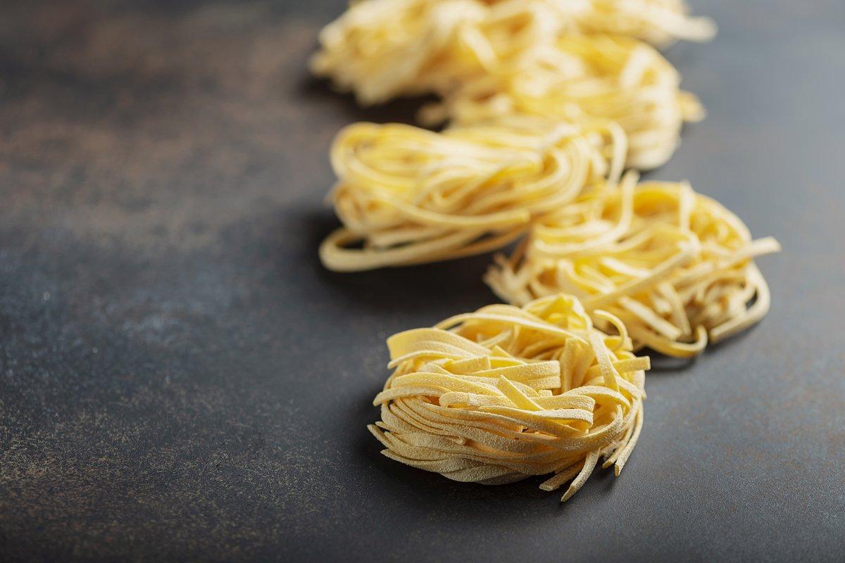 Traditional italian raw pasta tagliatelle example image 1