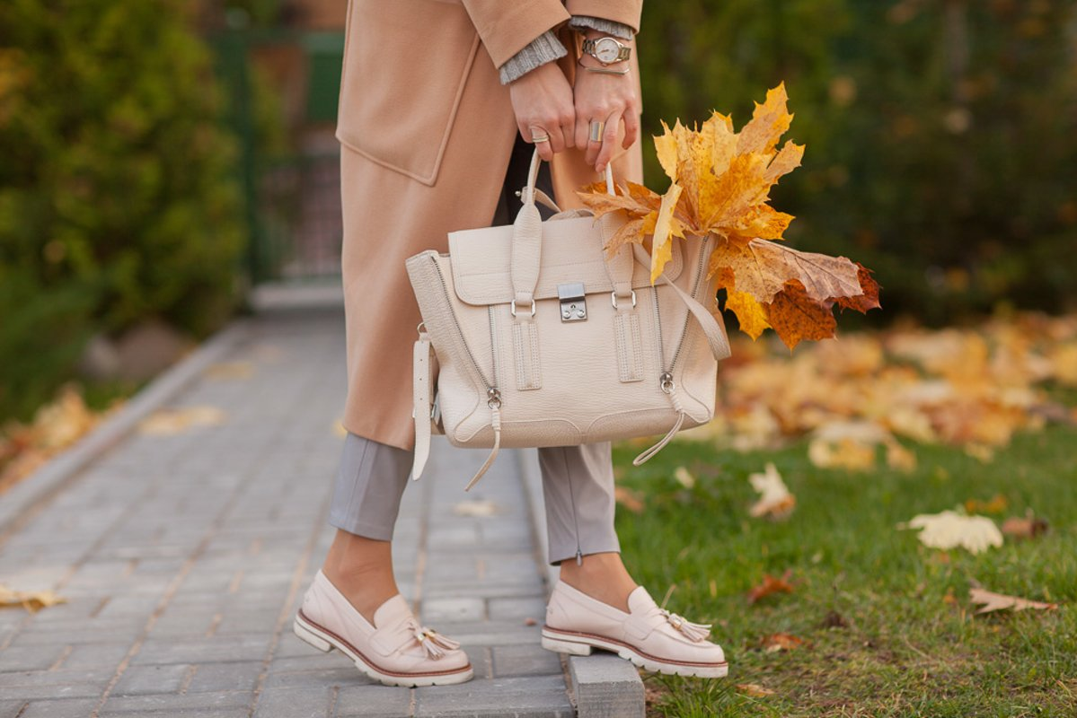 Details of clothes, autumn image of a girl, coat and bag example image 1