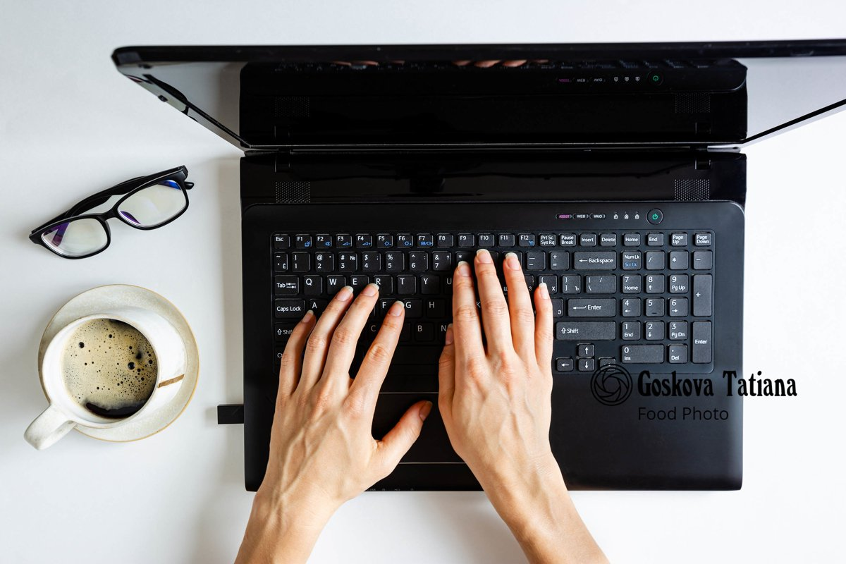 Photo of black laptop and girls hands example image 1