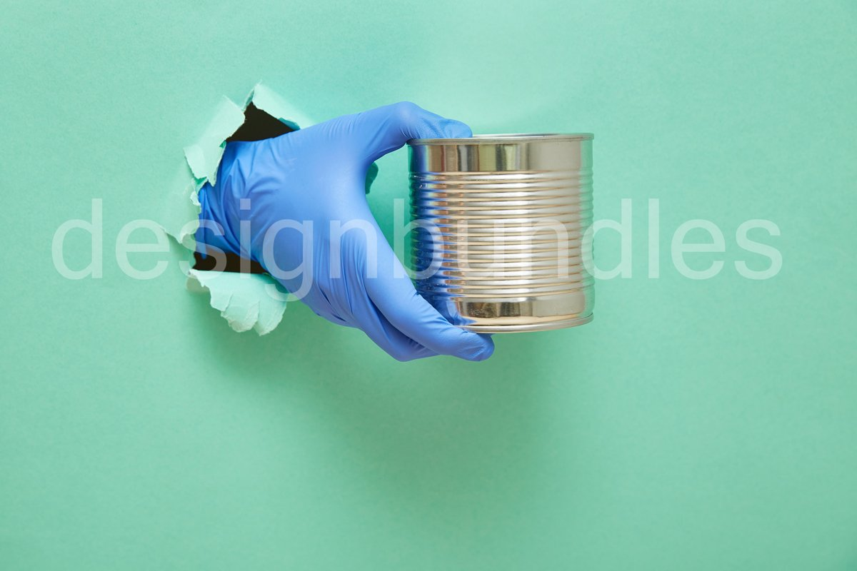A hand in a blue protective rubber glove holds an iron can example image 1