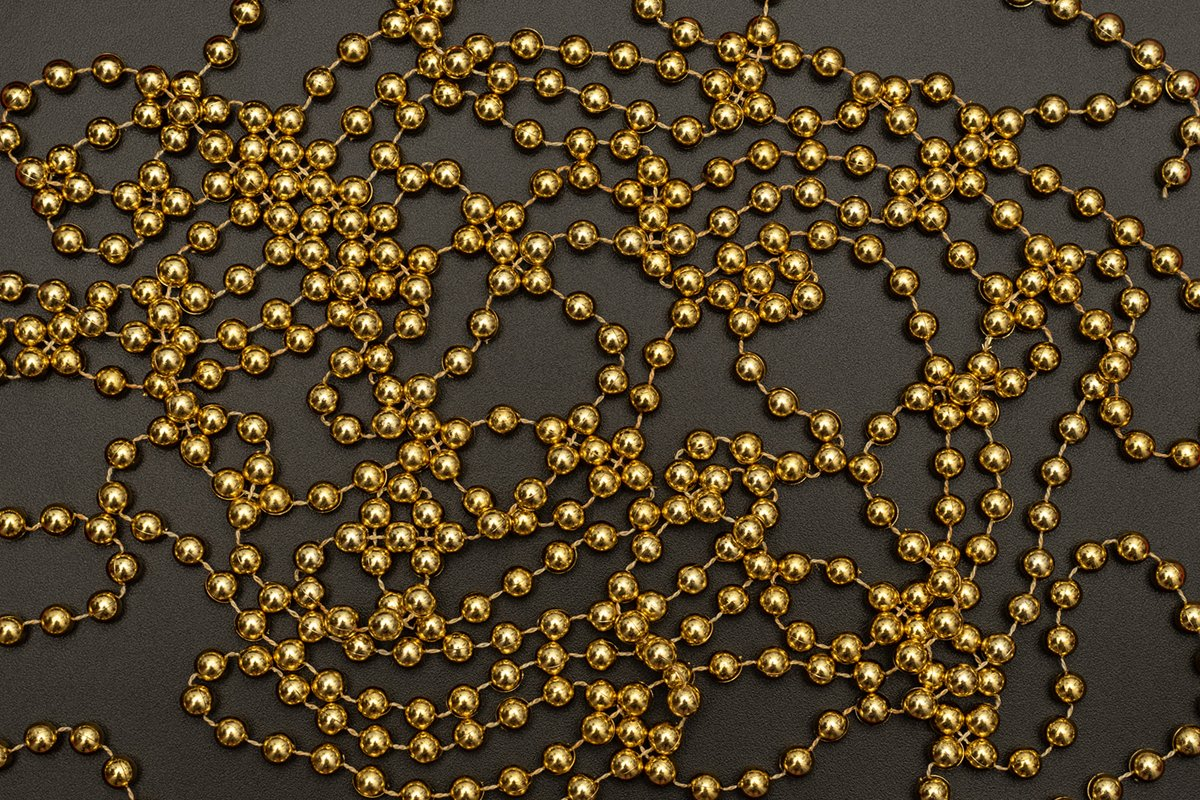 Christmas black background with golden beads. example image 1