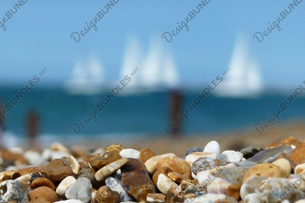 Stock Photo - Close up of pebbles on rocky beach example image 1