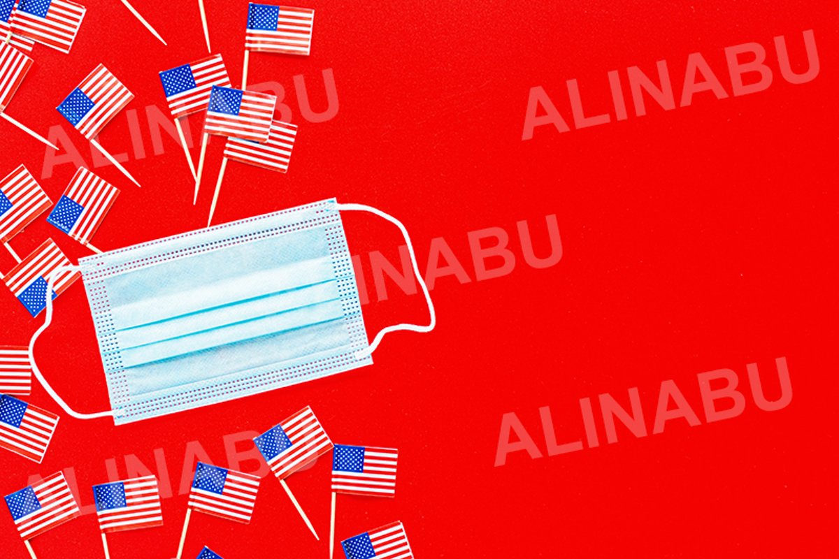July 4th. USA flags and medical mask on red background example image 1