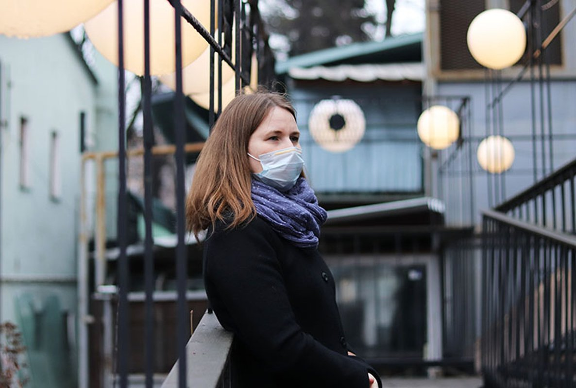 young european woman in protective disposable medical mask. example image 1
