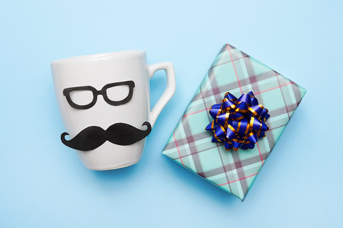 handmade White male cup and gift box on blue background example image 1