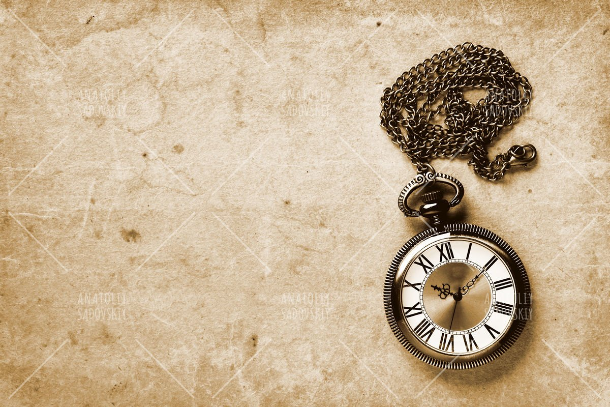 Vintage watch on old paper background example image 1