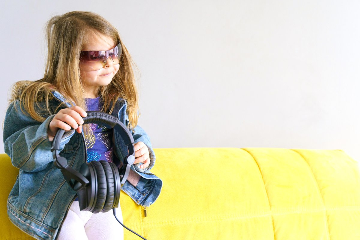 Little hipster girl in denim jacket in sunglasses. Fashion example image 1