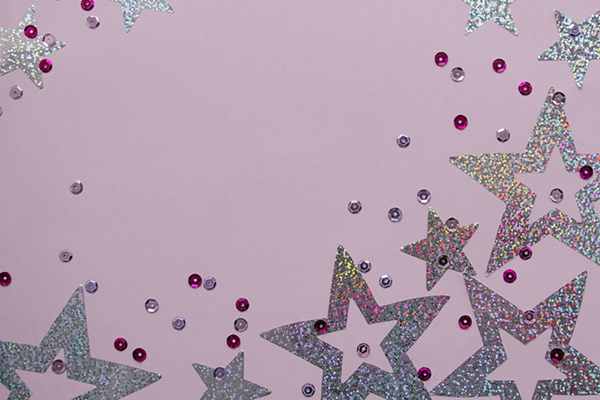 Silver sparkling christmas decoration on pink background. example image 1