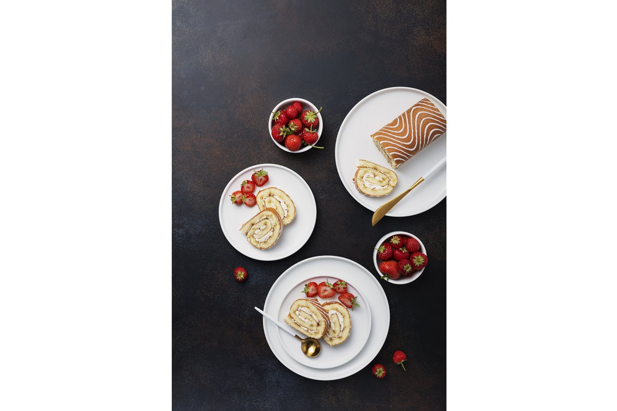 Sweet roll cake with white biscuit, cream and strawberry example image 1