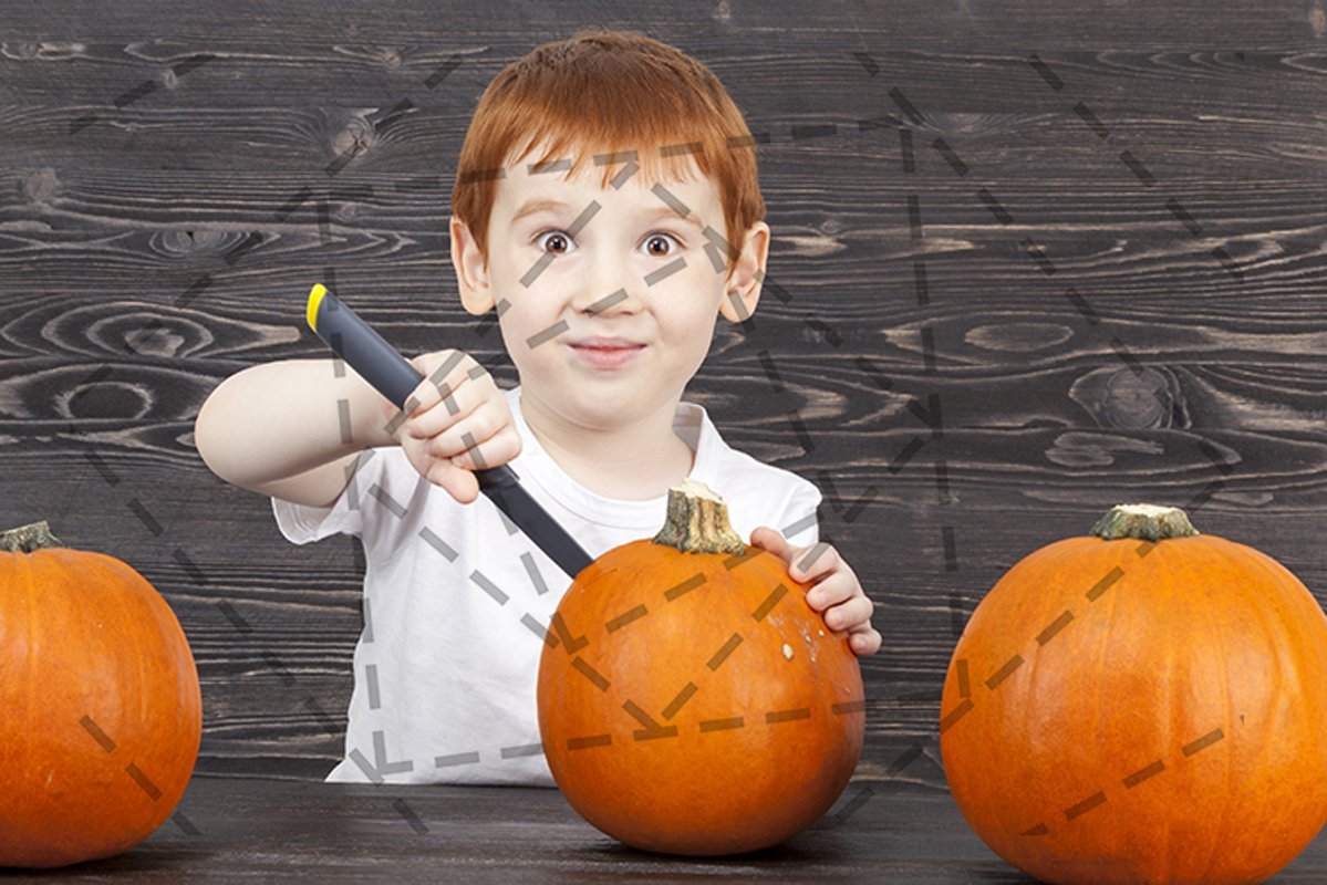 Red-haired boy cuts pumpkins example image 1