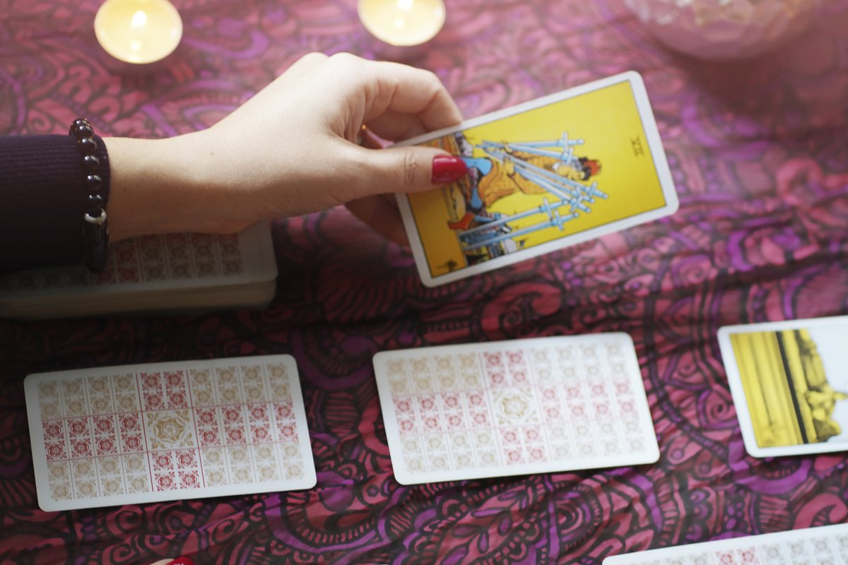 Defocused mystic ritual with tarot cards example image 1