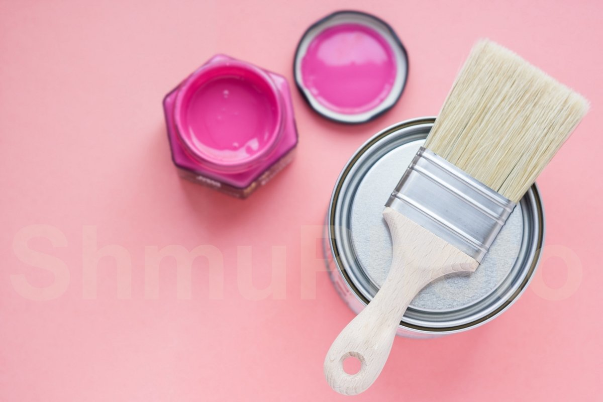 Paint can with purple paint and new brush on pink background example image 1