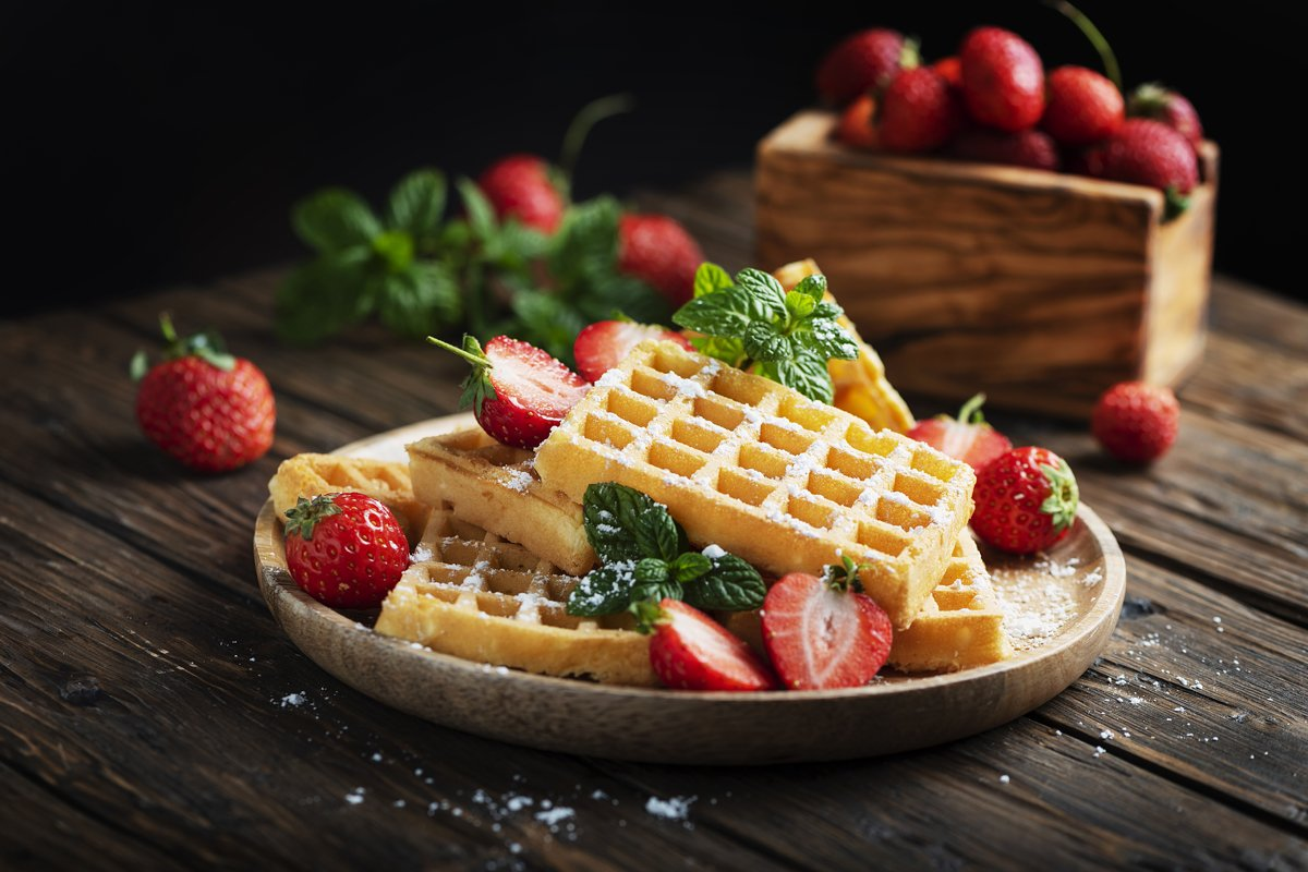 Homemade sweet waffle with powder sugar, strawberry and mint example image 1