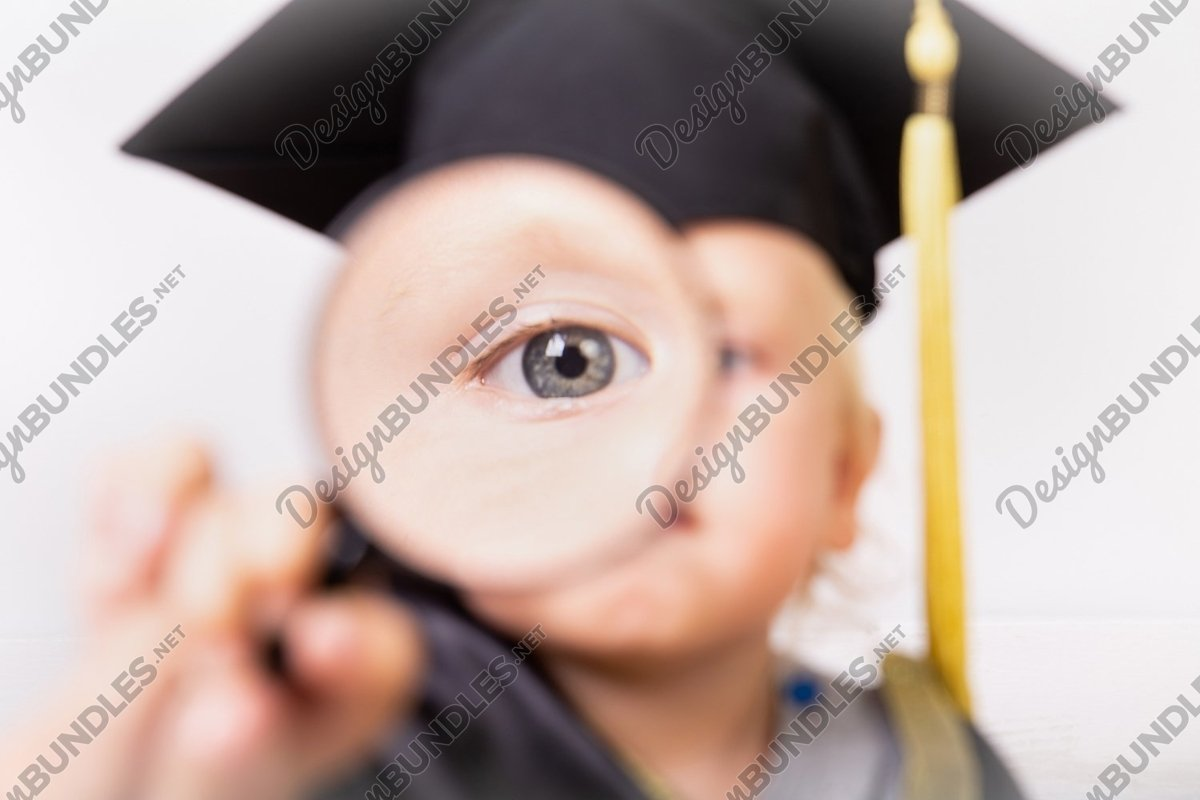 Photo of a boy looks through a magnifying glass example image 1