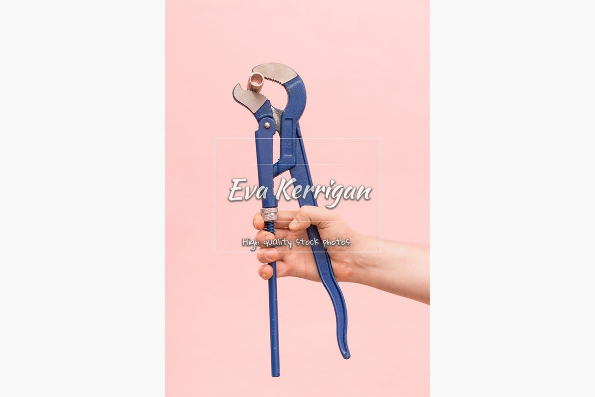 Blue pipe adjustable pipe gas plumbing wrench in a male hand example image 1