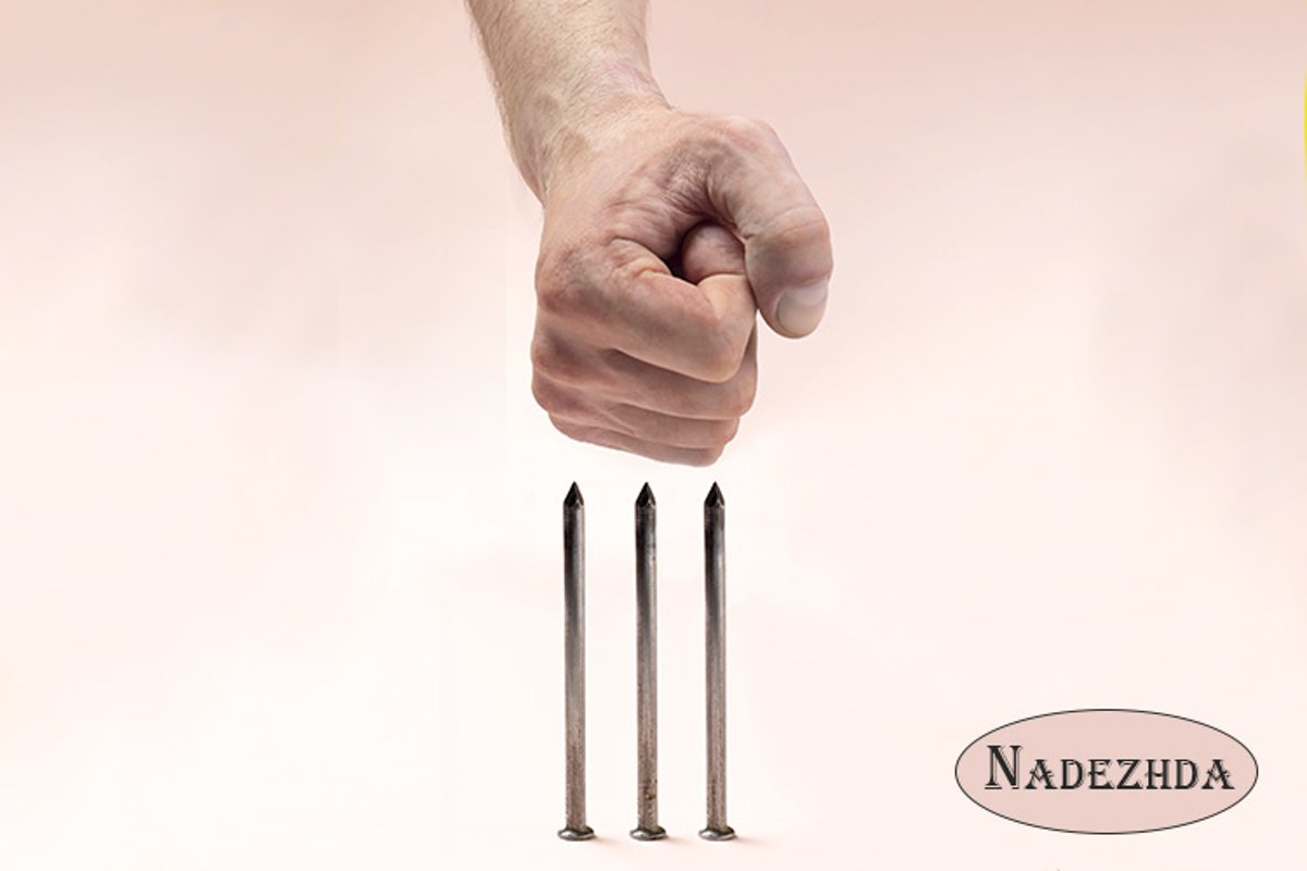 Human fist against sharp nails example image 1