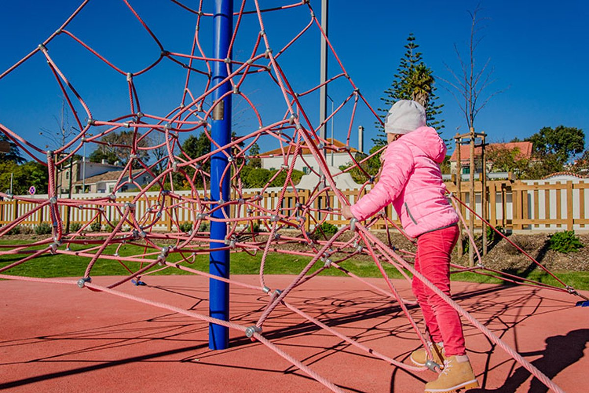 Little girl on a playground climbs upstairs. example image 1