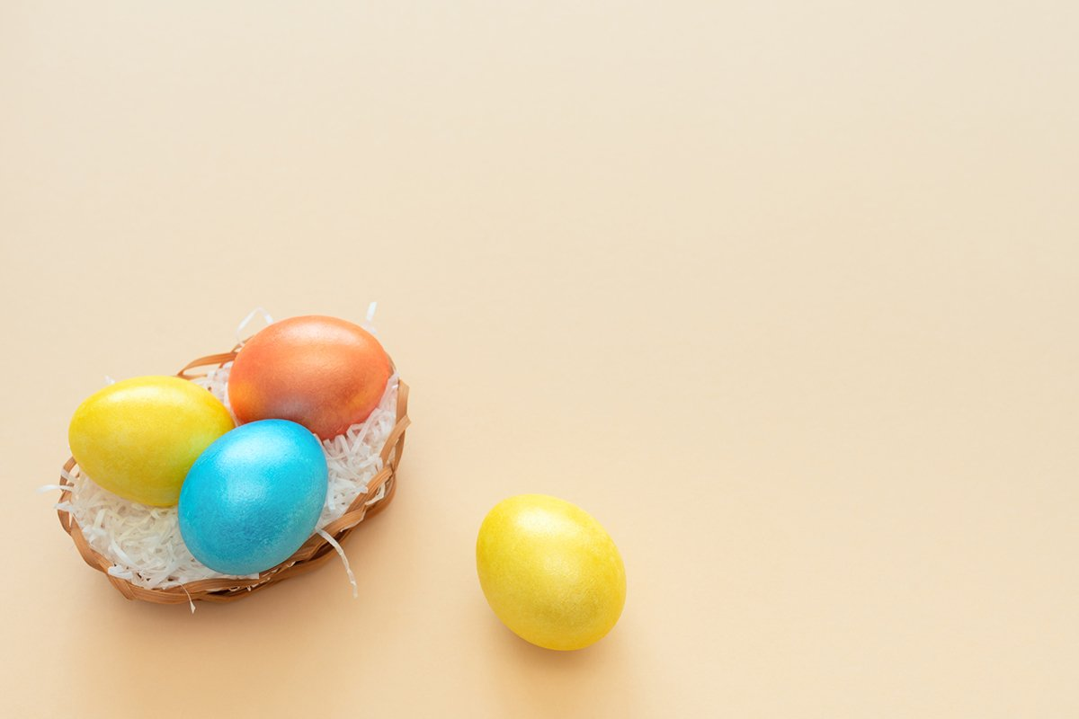 Decorated Easter eggs lie in the basket like a nest example image 1