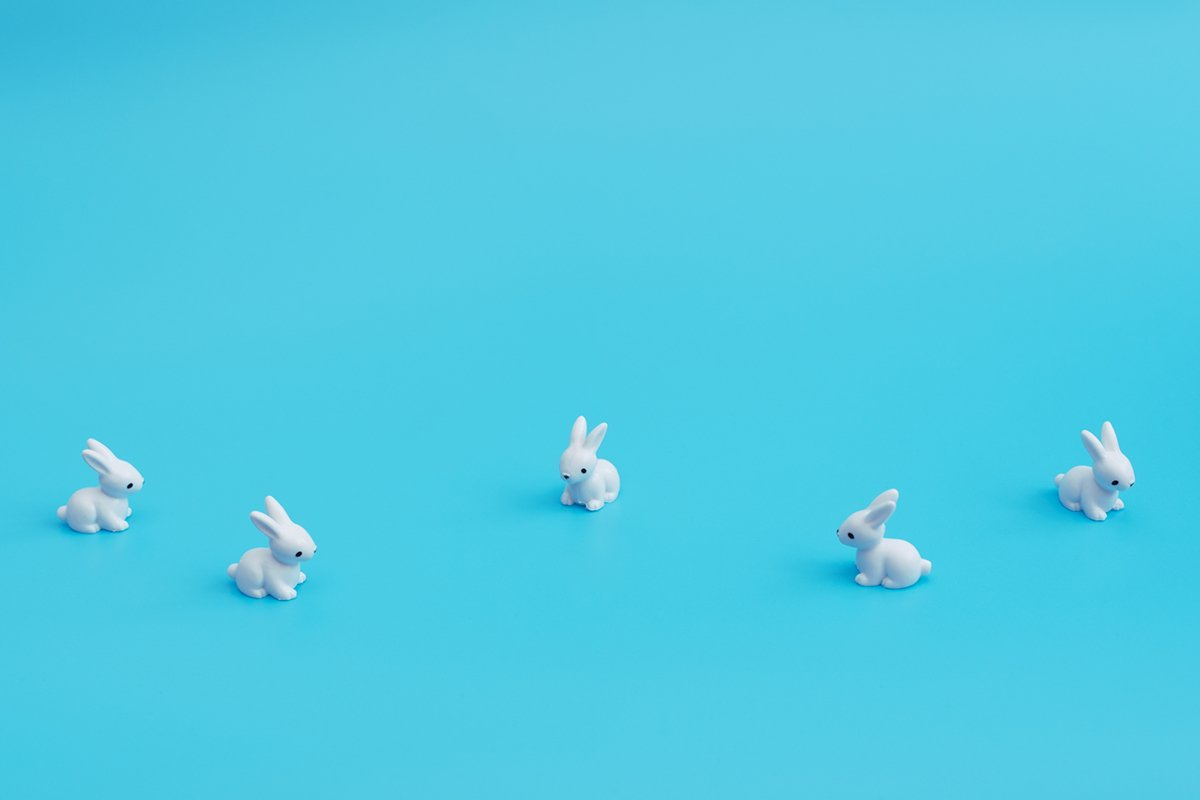 A lot of small white rabbits on blue background. example image 1