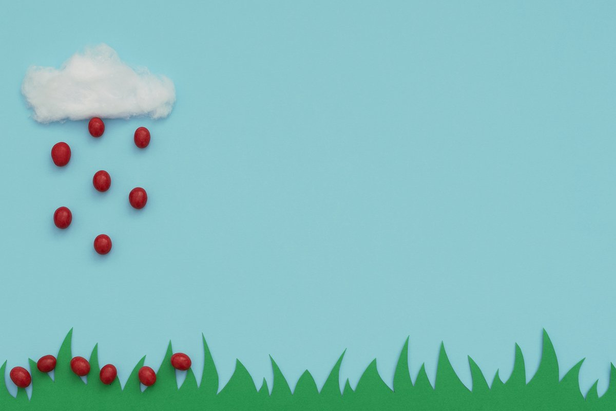 White cotton cloud and the rain of small red Easter eggs example image 1