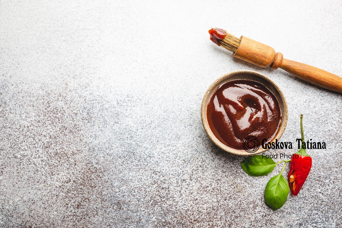 Photo of Barbecue sauce in a saucer with basting brush example image 1