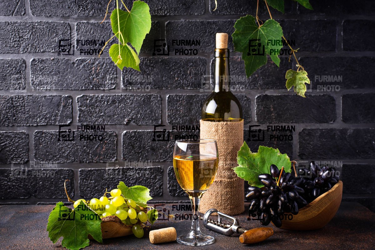 Bottle and glass of white wine example image 1