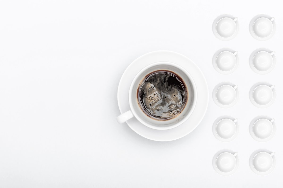 white cup of coffee on a saucer example image 1