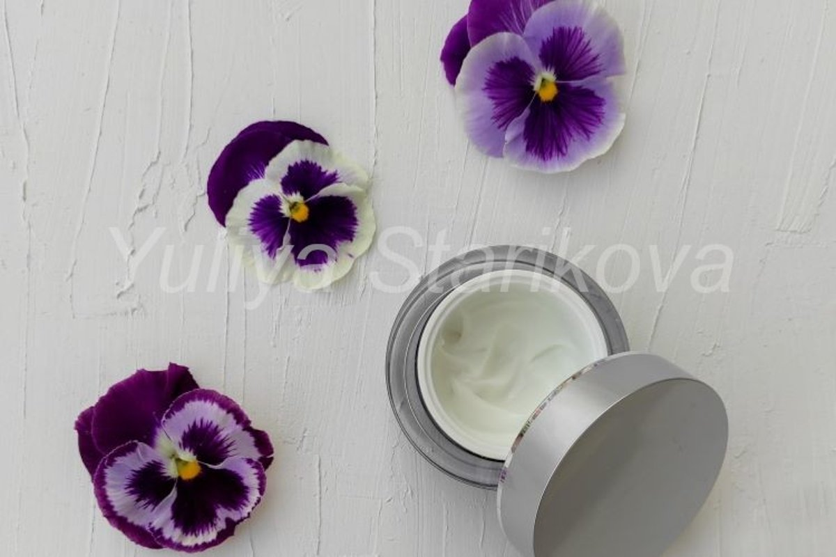 Jar of beauty cream with pansies flower. Skin care cosmetic. example image 1
