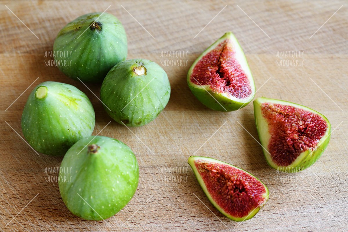Fresh figs on wooden cutting board example image 1