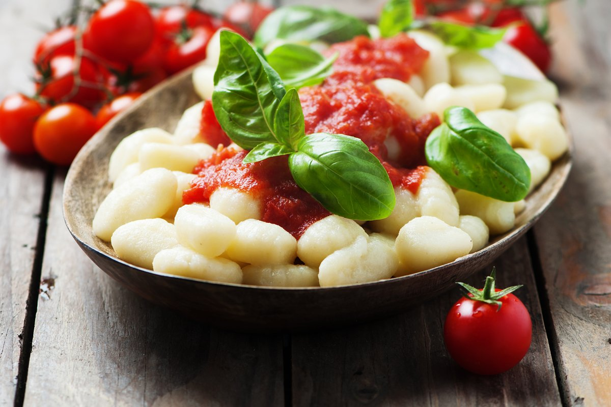 Italian gnocchi with tomato and basil, selective focus example image 1