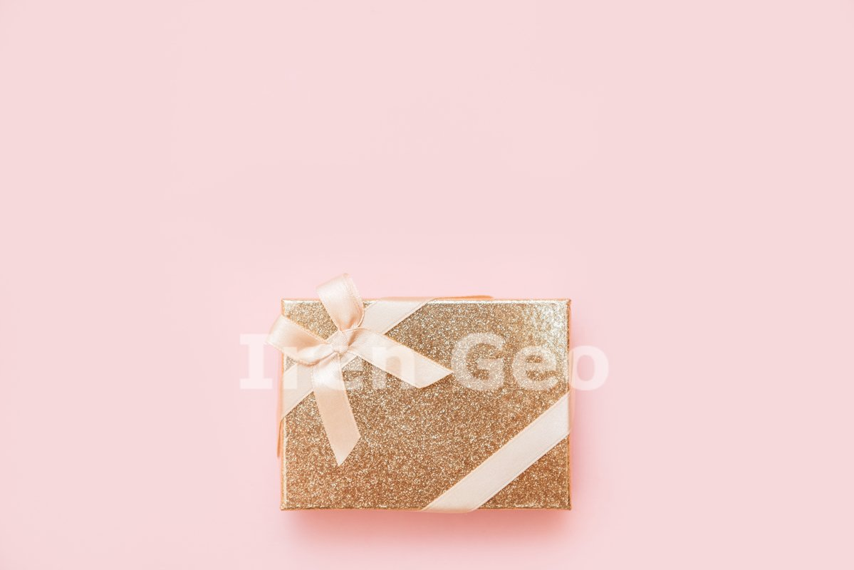 Flat lay of romantic gift decorated with ribbon example image 1