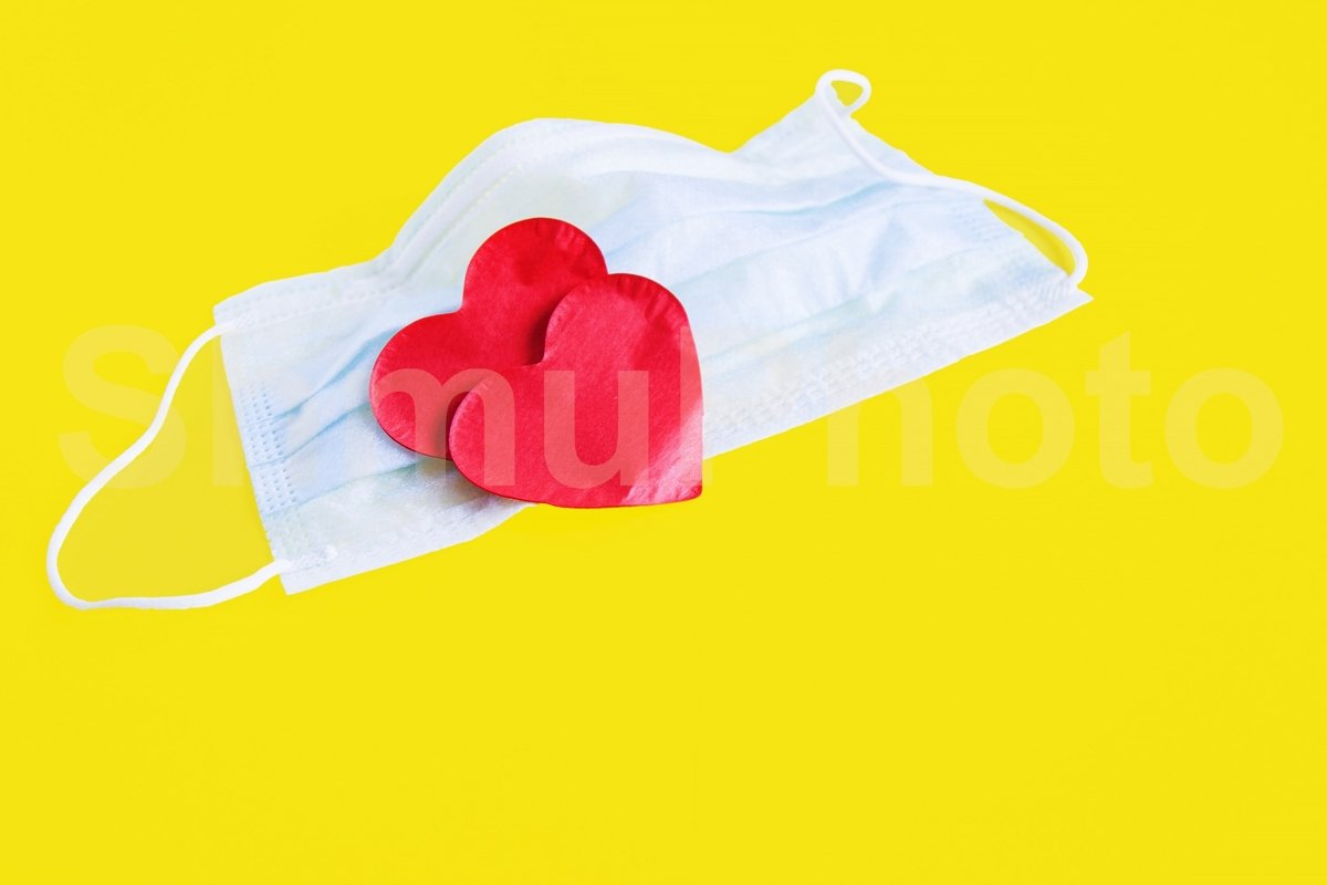 Blue cloth medical mask with two red heart on yellow example image 1