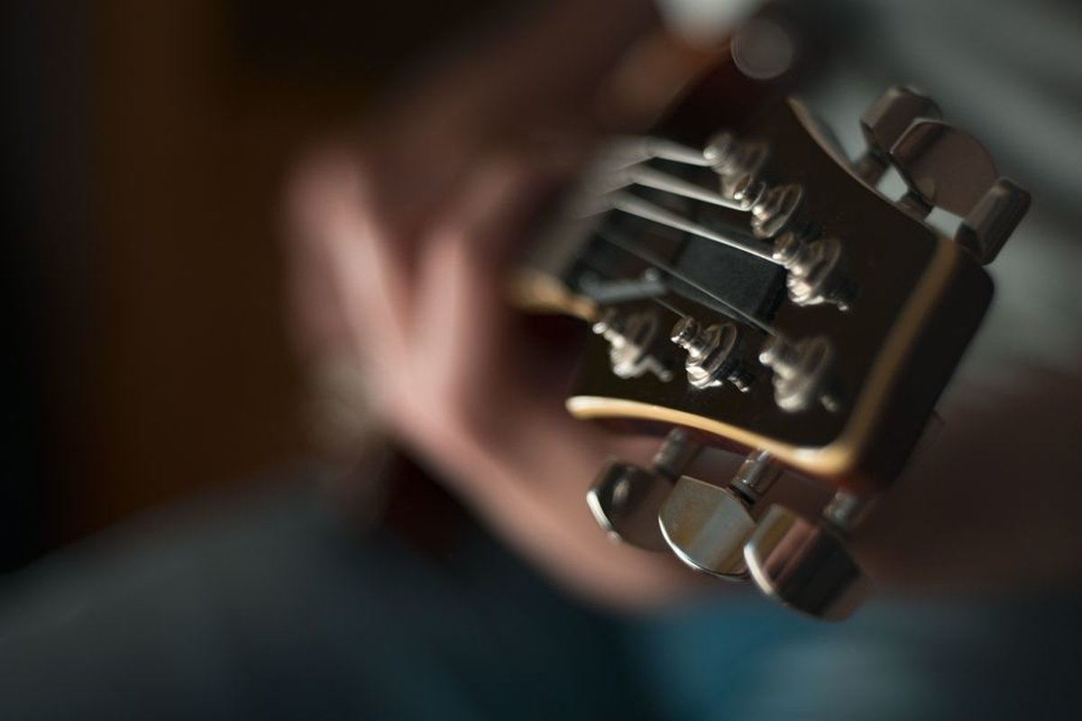 Man plays on electric guitar in studio example image 1