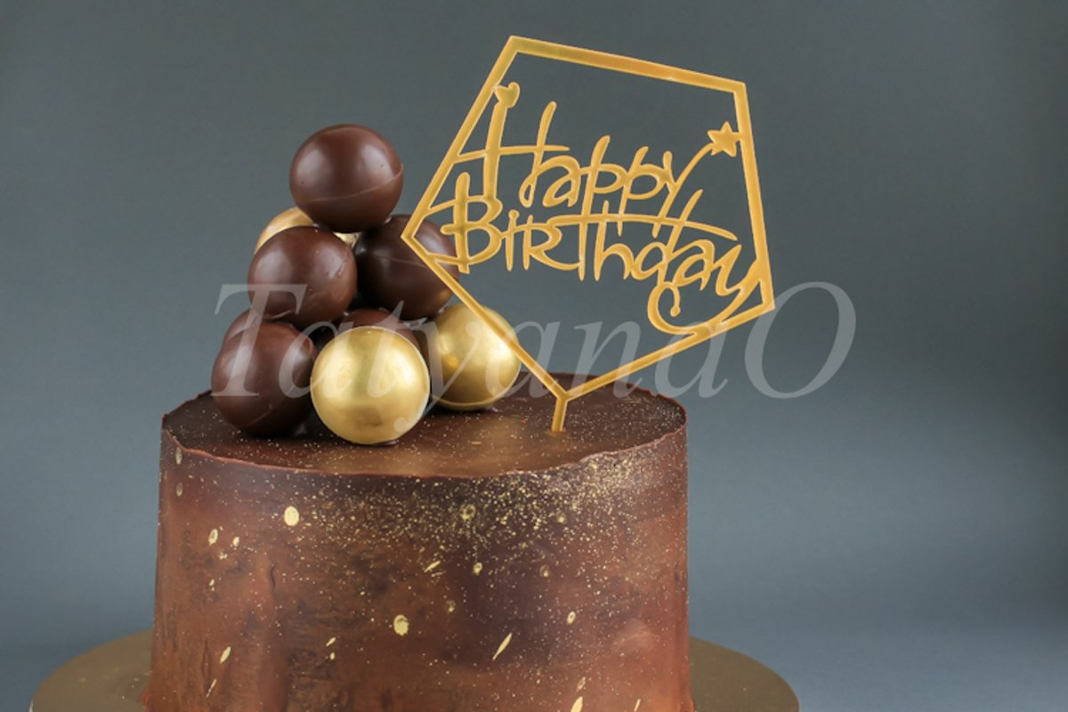 Chocolate birthday cake with gold decorations. example image 1
