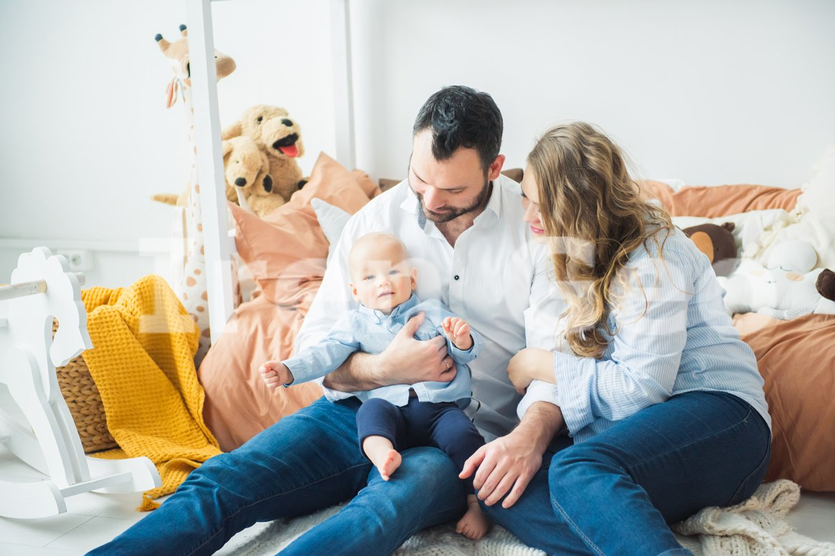 Happy family mother, father, child baby son at home example image 1
