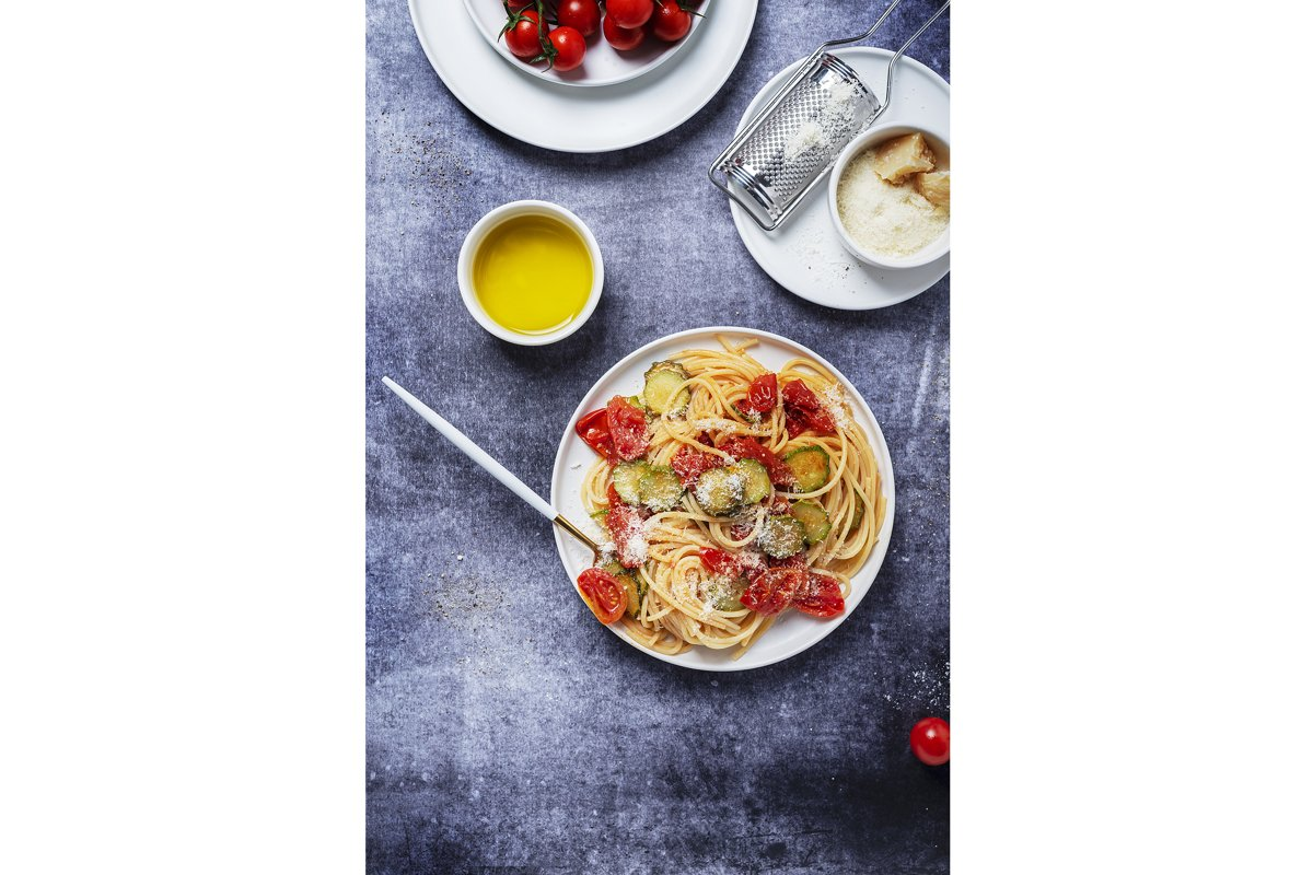 Traditional Italian pasta with tomato, zucchini and parmesan example image 1