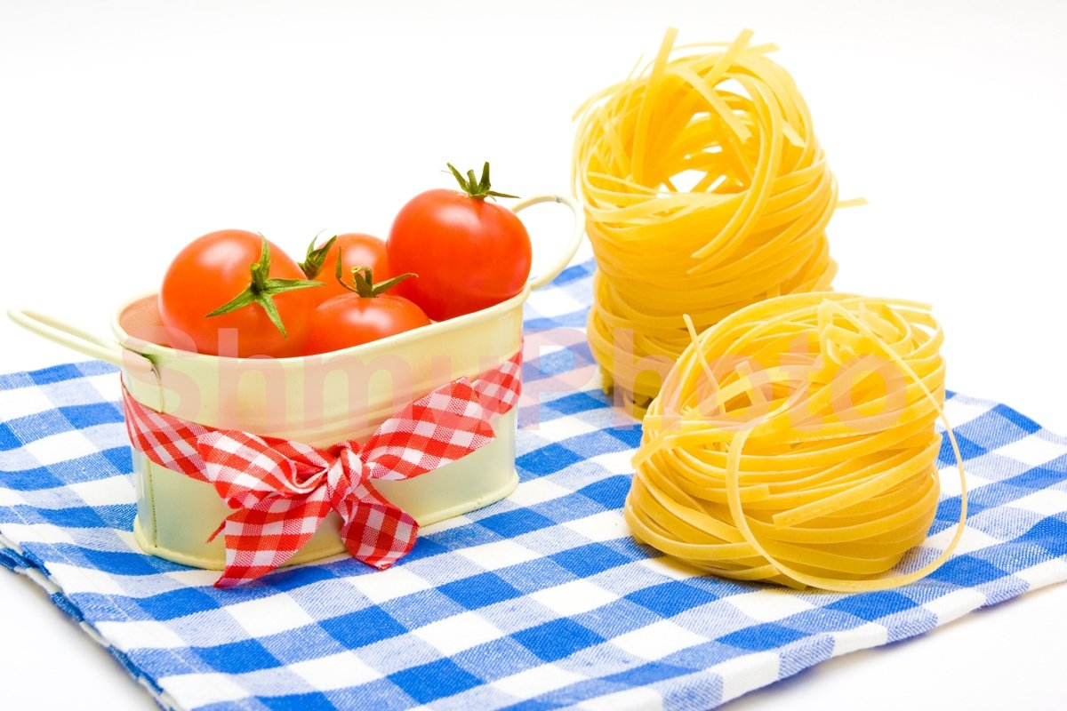 Pasta nest and tomatoes cherry on plaid napkin example image 1