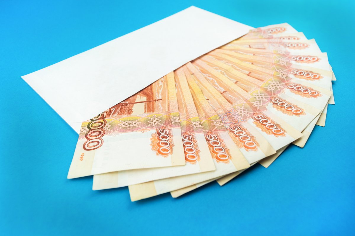envelope with Russian currency on a blue background example image 1