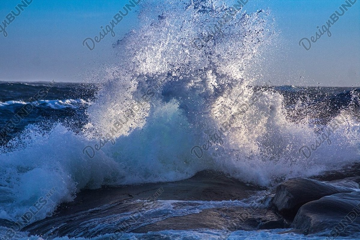 Stock Photo - View Of Waves In Sea Against Sky example image 1