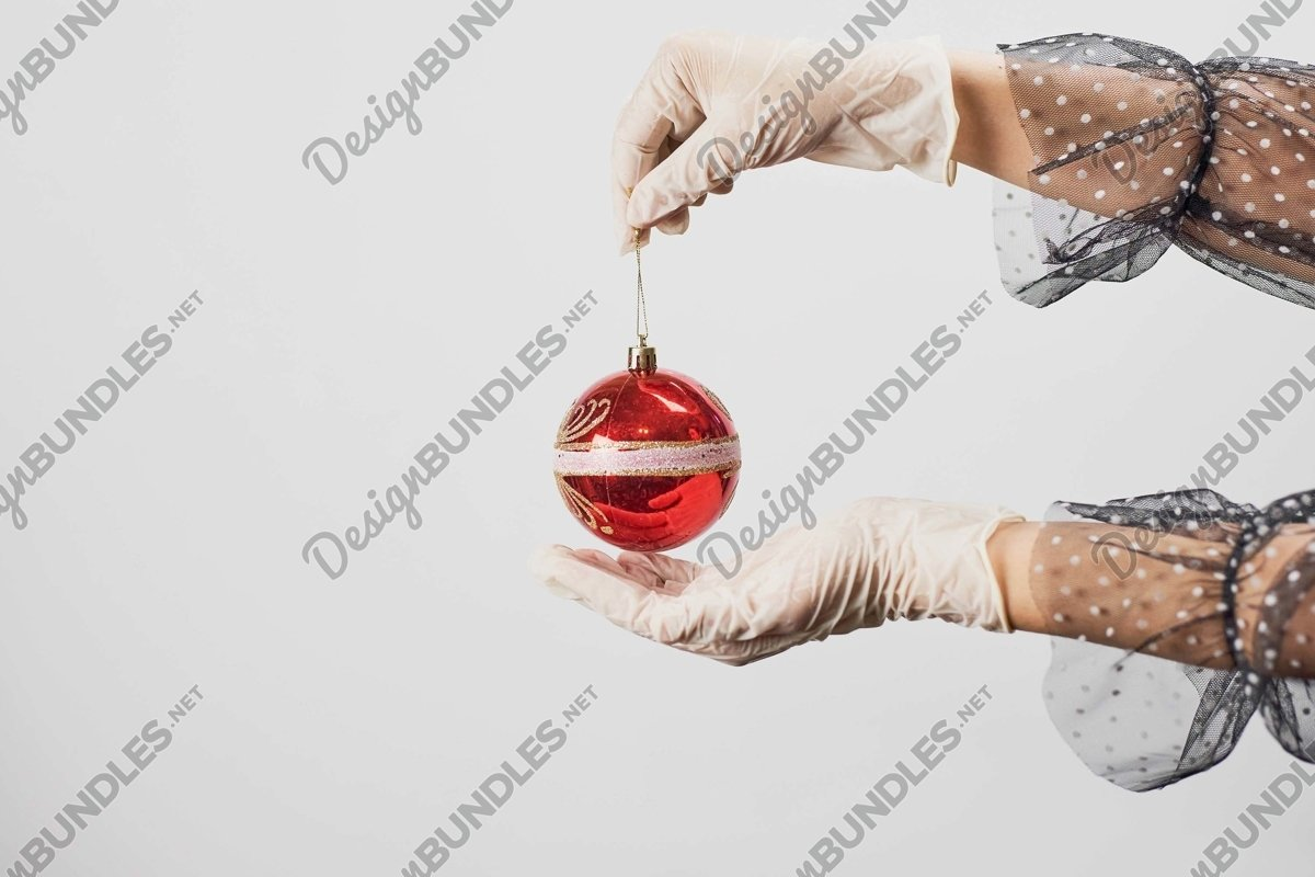 Stock Photo - Women Hand Holds Christmas jewelry example image 1