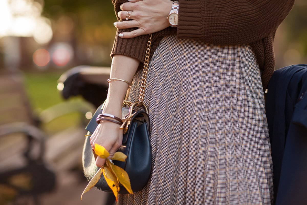 Autumn, details of clothes, a girl in an autumn image example image 1