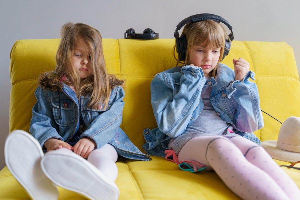Hipster girls in denim jackets. Headphones, sunglasses, hat example image 1