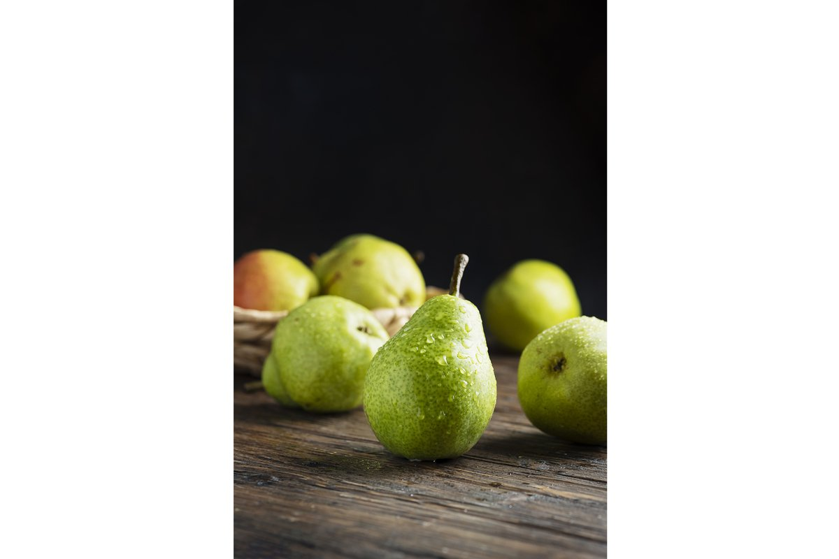 Sweet green pears on the wooden rustic table example image 1