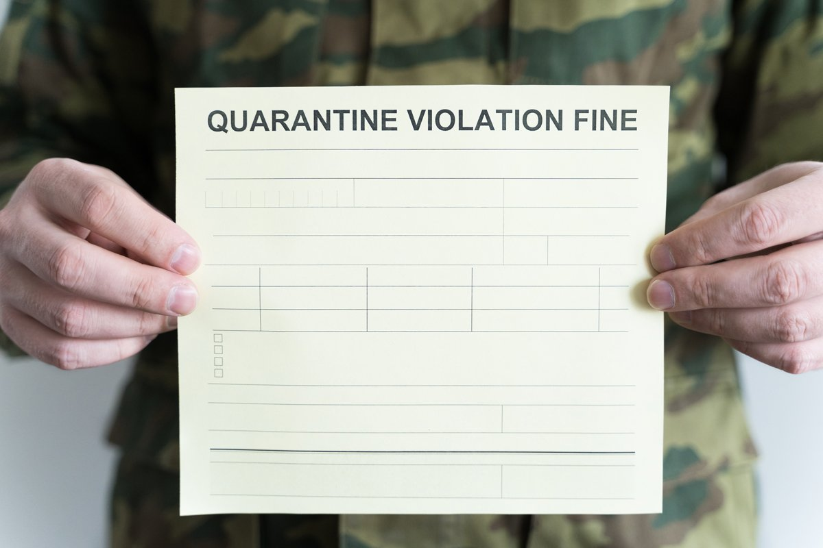 Police officer with self-isolation violation fine. Receipt example image 1