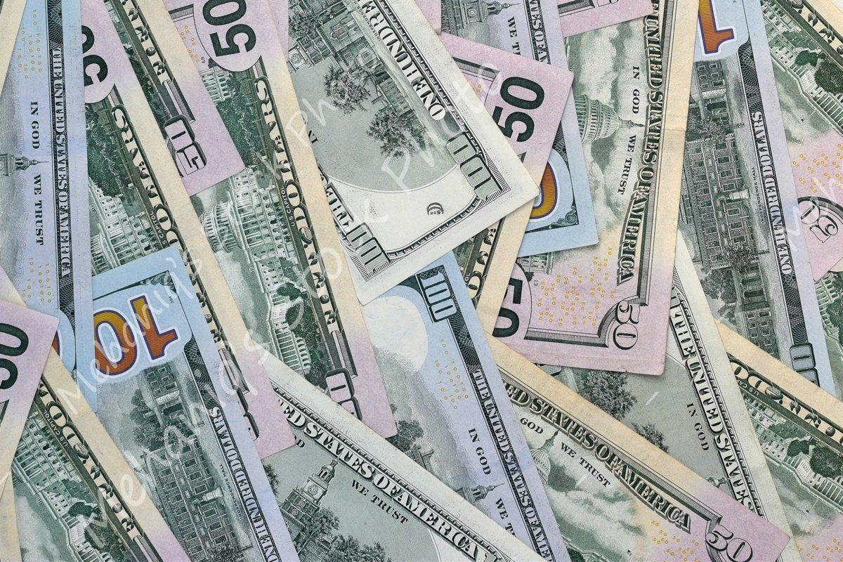 Many american dollar bills close up example image 1