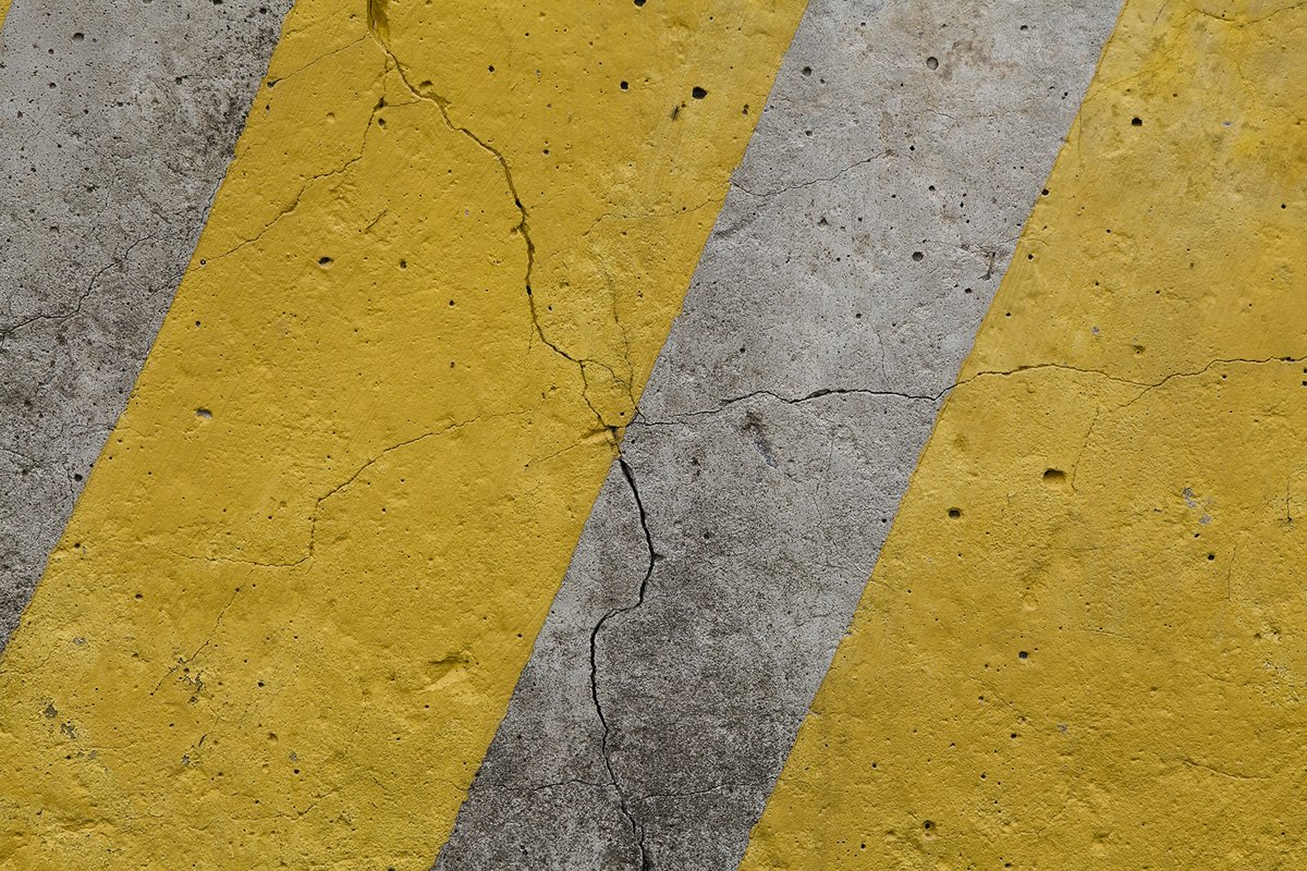 Grunge grey wall with yellow stripes. example image 1