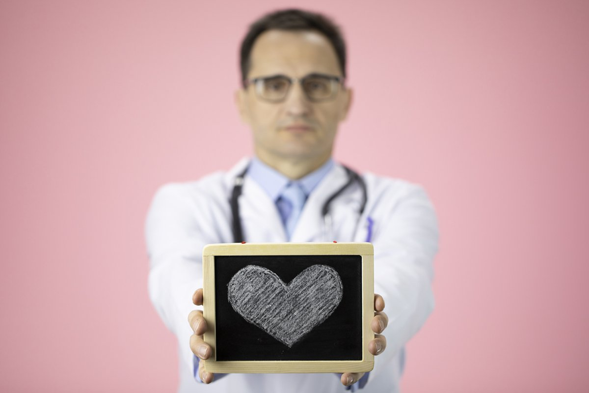 Doctor therapist with a stethoscope on a pink background example image 1