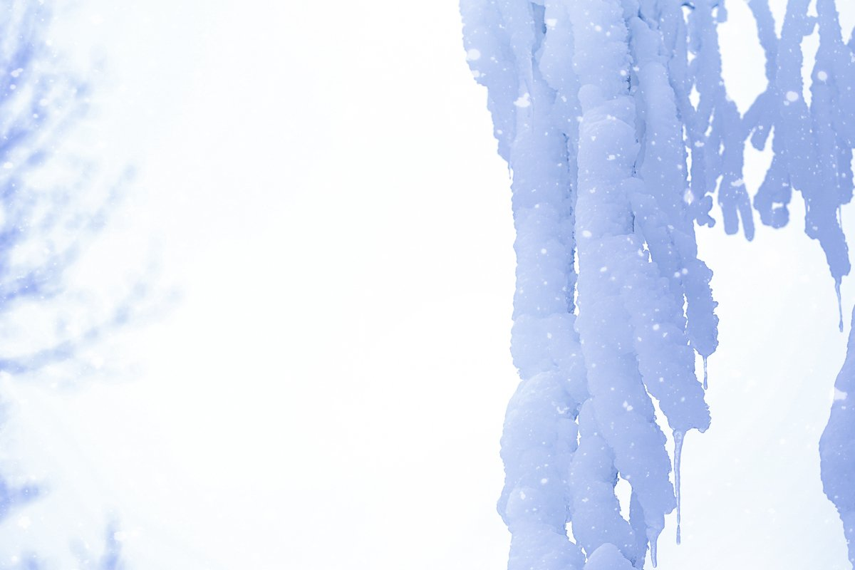 Huge icicles on trees in winter example image 1